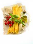 Composition of pasta spaghetti vegetables, spices and oil — Stock Photo