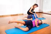 Teacher explaining young boys fitness exercises to balance the body — Stock Photo