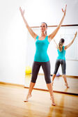 Young woman making fitness exercises stretching witn open arms — Stock Photo