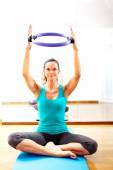 Fitness teacher making exercisese with the circle tool — Stock Photo