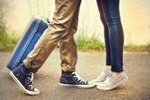 Legs of two lovers meet with suitcase — Stock Photo