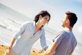 Couple in love talking in front of the sea — Stock Photo