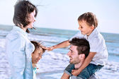 Boy caresses his brother with love with his family to the sea — Stock Photo