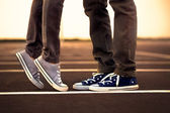 Meeting of legs between two lovers — Stock Photo