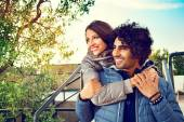 Smiling Couple with Arms Around Each Other Outside — Stock Photo