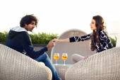 Couple holding hands while drinking an aperitif — Stock Photo