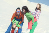 Family having fun in the snow — Stock Photo