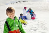 Young boy having fun in the snow — Stock Photo