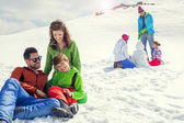 Two families having fun in the snow — Stock Photo