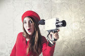 Woman has fun filming with the camera — Stock Photo
