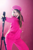 Young singer woman in pink performing — Stock Photo
