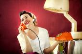Vintage housewife chats on the phone in Hair salon — Stock Photo