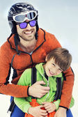 Father hugs his son affectionately in the snow — Stock Photo