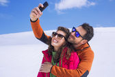 Couple having a selfie on the snow in montain — Stock Photo