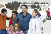 Two families with children walking in the snow — Stock Photo