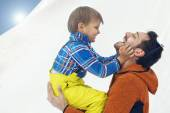 Father hugging his son affectionately in the snow — Stock Photo