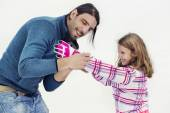 Father helps his loving daughter to wear gloves — Stock Photo