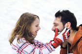 Father hugs his daughter affectionately in the snow — Stock Photo