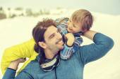 Father lifting his son affectionately in the snow — Stock Photo