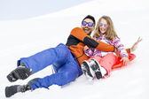 Girl and his father sledding very fast in montain — Stock Photo