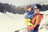 Father carrying his son to wonderful winter landscapes — Stock Photo