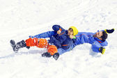 Little boy and his father sledding very fast — Stock Photo