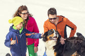 Family and their dog having fun in mountain — Stock Photo