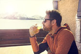 Seated and relaxed man drinking a beer in peace — Stock Photo