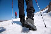 Hiking boots on the mountain trail — Stock Photo