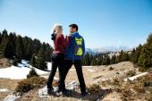 Two hikers with backpack standing top of mountain — Stock Photo