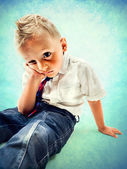 Angry and rebel little boy in the school — Stock Photo