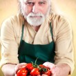 Farmer shows his biological vegetables — Stock Photo #75182243