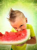Punk boy eating a big slice of watermelon — Stock Photo