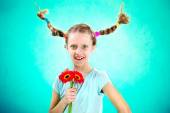 Cool and funny girl showing her flowers — Stock Photo