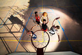 Young basketball players playing with energy — Stock Photo