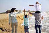 Family enjoyed walking on the beach at the sea — Stock Photo