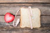 Slice of wholemeal toast with tape measure isolated — Stock Photo