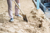 Man digging in the ground with shovel and spade — Stock Photo