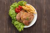 Grilled pork chop steak and vegetables with french fries on wood — Stock Photo