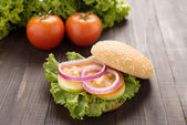 Vegetable hamburger with french fries on the wooden background. — Stock Photo