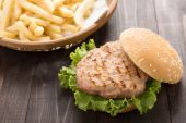 Bbq hamburger with french fries on the wooden background. — Stock Photo