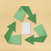 Recycle crumpled paper recycling symbol on paper background. — Stock Photo