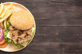 Top view bbq hamburger and french fries on the wooden background — Stock Photo