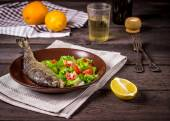 Fish with salad and white wine — Stock Photo