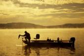 Bass fishing in morning sun and fog — Foto Stock