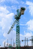 Building and crane, facility construction — Stock Photo