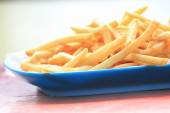 Bowl of french fries on wooden table — Stock Photo