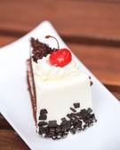 Cheesecake with Chocolate Sauce and Cherries — Stock Photo