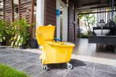 Mop bucket on floor in toilet — Stock Photo