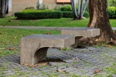 Concrete chair in the park — Stock Photo